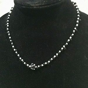 """Jewelry - A 17"""" strand of black and white glass beads"""